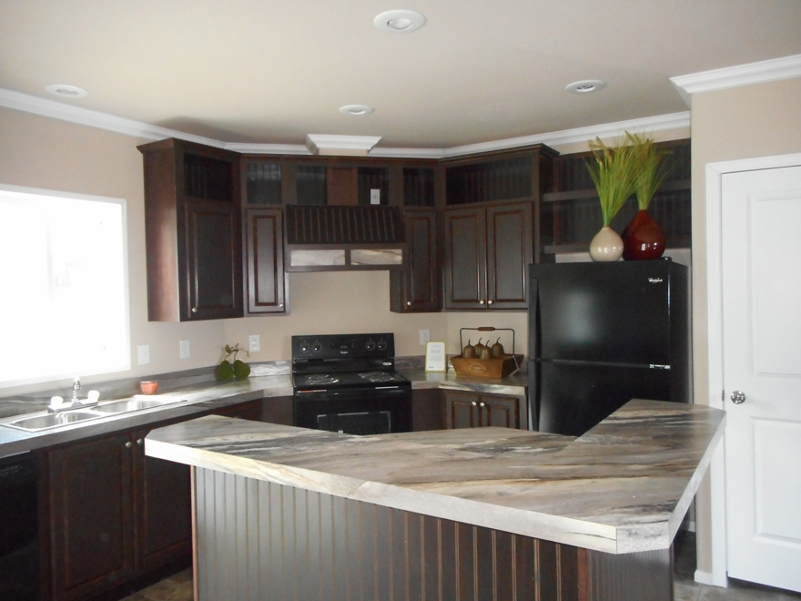 Kitchen includes large window over the sink and also standard recessed lighting.  Ceiling crown molding is an upgade.